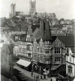 A long view of the F. W. Woolworth store in High Street, Lincoln, with the Cathedral in the background