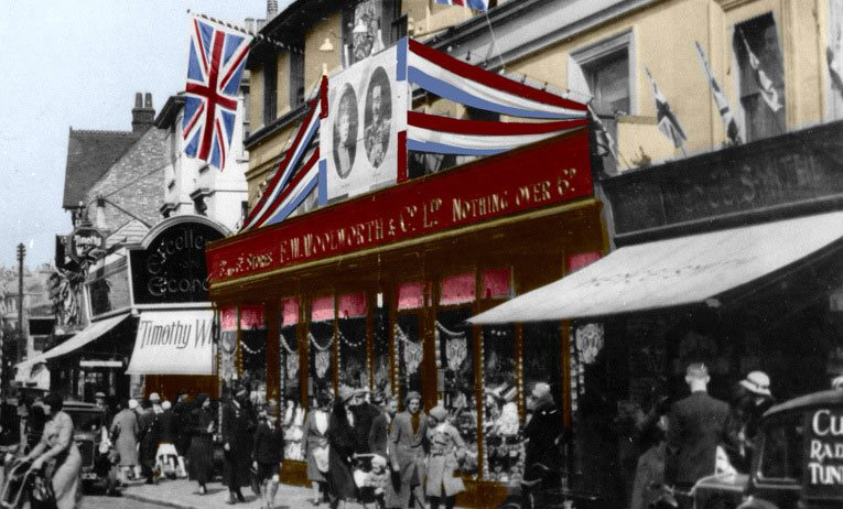 The exterior of F. W. Woolworth in Calverley Road, Tunbridge Wells dressed with bunting, flags and pictures of Their Royal Majesties for the Silver Jubilee of H. M. King George V and Queen Mary in 1935.