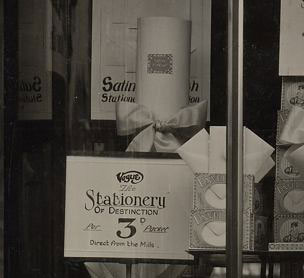 A window display promoting Woolworths' latest line in stationery - luxurious paper straight from the mill at threepence (1½p) per pad