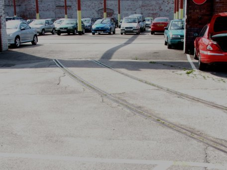 The tracks were still visible in 2008, when the one-time marshalling area served as a staff car park for the Castleton Site.  Sadly, despite featuring that year at an international SAP conference as a role model distribution facility, no-one could be found to take the site over when the business went into Administration in November 2008.