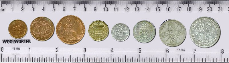 Pounds, shillings and pence - British currency for over 500 years until 1971. Left to right: farthing, halfpenny, penny, threepence, sixpence, shilling, florin and half crown