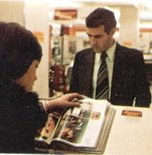 Customers browsing the Shoppers World Catalogue at the Order Point in-store