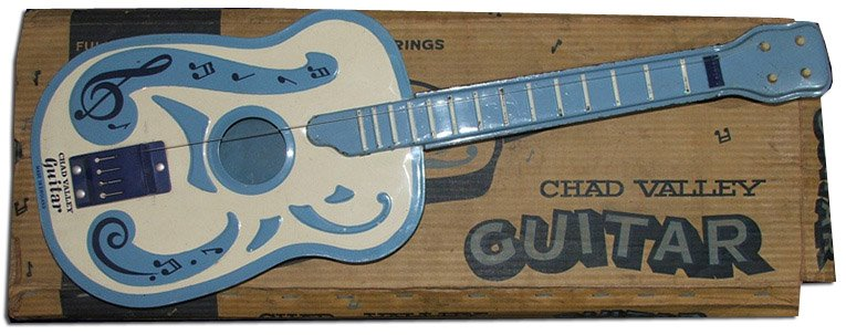 The Chad Valley guitar, one of a range of musical instruments inspired by the new music of the Sixties.  Many a budding musician first played a guitar like this!