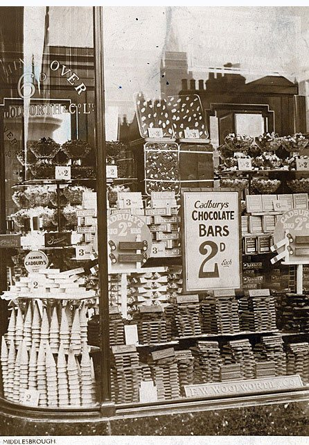 Weigh out sweets and miniature 3oz (85g) chocolate bars from Cadbury in the windows of Woolworths Middlesborough store in the early 1930s.  Click for a full size view.