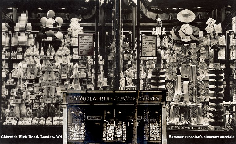 Bold features of sixpenny items for the summer sunshine, in the windows of the F.W. Woolworth store in Chiswick High Road in West London in 1937