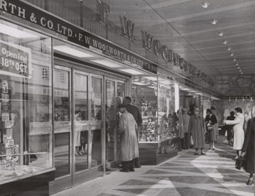 Customers take a sneak preview through the window of Oxford's new F. W. Woolworth store in 1957