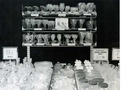 A new tiered display of glassware in a Woolworth store in 1948, some of the prices were more than ten times higher than they had been a decade earlier.