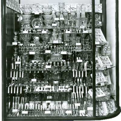 A 1951 Woolworth window display in 1951, featuring a complete range of glassware and cutlery