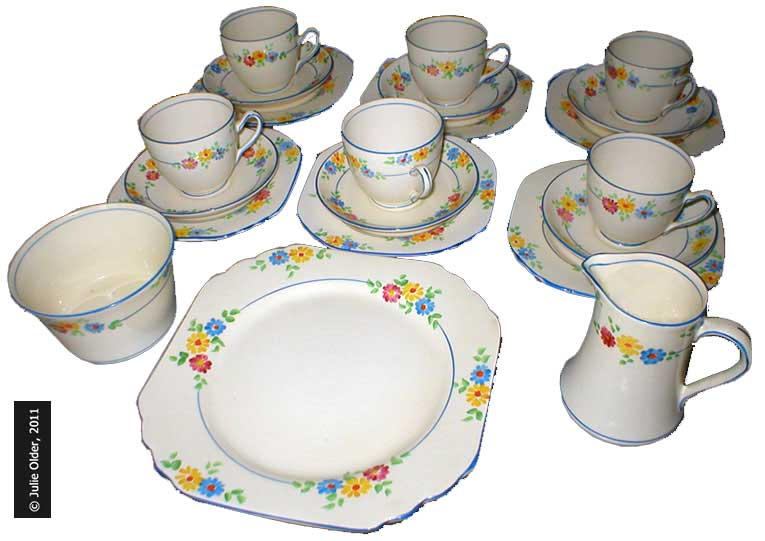 A fine example of a Thirties 21-piece Teaset from F.W. Woolworth, perfectly preserved after eighty years. It includes a cake plate, sugar bowl, cream jug and six teacups, saucers and teaplates. In 1931 the complete set sold for ten shillings (50p at the time, equivalent to £21 today). Picture with special thanks to Julie Older.