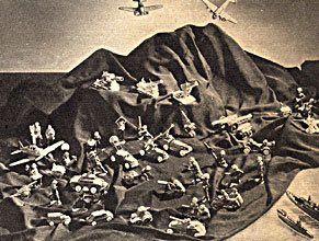 More than a little ironic, the F. W. Woolworth USA catalogue from 1940 included a spread of Japanese tinplate toy boats, submarines are aeroplanes all arranged around a harbour.