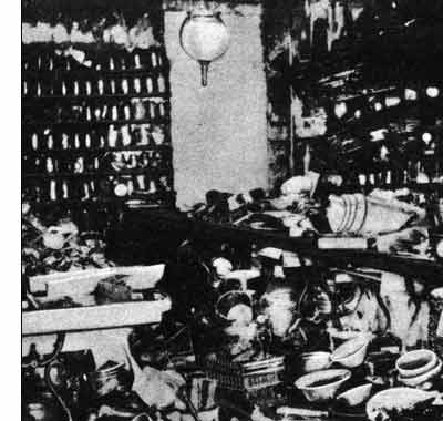 The ramshackle interior of the first successful Woolworths store in Lancaster, Pennsylvania, USA, which was lit by a single gas lamp