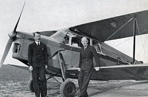Eric Pasold and London Agent A. C. Hurst stand in front of Ladybird's first company plane.
