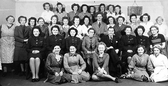 The staff of the Long Eaton store, pictured in 1947. The Store Manager, Mr. H.S.Bendall, is in the centre foreground. Bill Pell was the only other male member of staff and appears sporting a moustache and wearing his stockman's coat