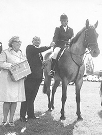 Bill and Joan Pell presenting the prizes at the Hertford Horse Show, which was sponsored by Woolworth's Winfield own brand