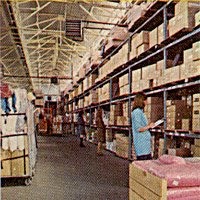 Staff pick goods for despatch to Shoppers World stores in the company's dedicated warehouse in Heywood, Lancashire in 1975