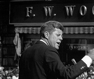President John F. Kennedy campaigns for the Democrats outside an F. W. Woolworth store in 1962