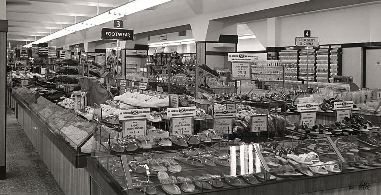 The salesfloor of the F. W. Woolworth store in Montego Bay, Jamaica pictured in around 1964. By this stage (despite signs in the foreground promoting Jamaican manufactured goods) overall the range has become more anglicised.