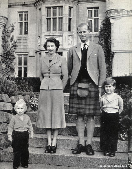 A Royal Family portrait taken at Balmoral in 1952 with Her Majesty the Queen, HRH The Duke of Edinburgh, Prince Charles and Princess Anne standing on the steps. Image courtesy of Studio Lisa, reproduced from the F. W. Woolworth New Bond magazine of June 1953