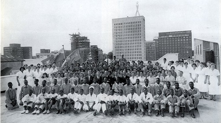 A team photograph taken on the roof of the Harare store to mark the opening of the first Woolworths in Zimbabwe (Southern Rhodesia) in 1958.  The store boasted 300 staff, nearly all full-time.