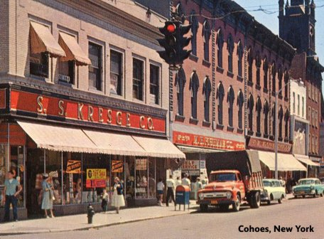 Three dimestores side-by-side in Cohoes, New York in the late 1950s.  From left to right S. S. Kresge Co., M. H. Fishman Co. and (in the smallest of the three), the originators of the genre F. W. Woolworth Co.