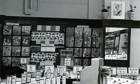 Bold displays of picture books and wrapping paper in the new Woolworth store in Warwick, which opened in 1952. (Note the patriotic picture of H.M. The Queen above the wall display)