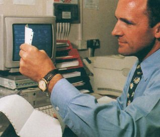 Flagship Woolworths store manager Brian Bower reviewing his store's performance at the new Back Office PC - 1992