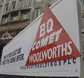 A hording on the forecourt at Marylebone canvases investors to reject the Dixons offer for Woolworths, April 1986