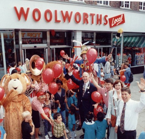 MD Roger Jones (centre), PR Executive Cathy Young and Proposition Manager Steve Langton (Right foreground) open the new-look Woolworths Local store in Greenford, Middlesex in 1997