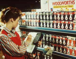 Light buld moment: a colleague uses a Telxon PTC-701 terminal to order light bulbs from Woolworths' new 'Range Book' in 1989