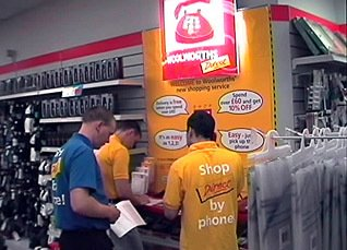 WoolworthsDirect team members Andy Lee and Afthab Khan inspect an in-store order point in 1998