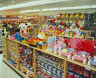 The selection of toys and games in a small, local High Street Woolworths store in the 1980s