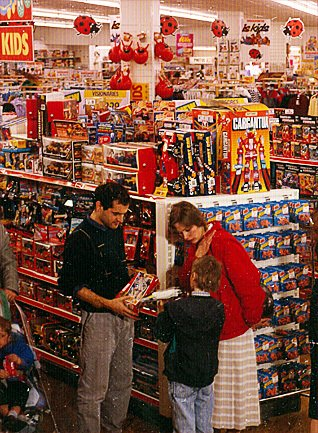 A family choose toys in a Woolworths store in the late 1980s
