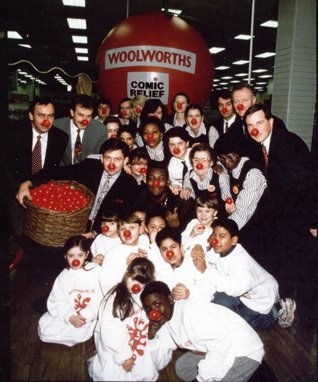 Red Nose Day 1992 - sponsored by Woolworths, with five Directors, Chris Ash, Don Sloan, Dan Bernard, Martin Toogood and Jim Glover posing for photographs behind Edgware Road Store Manager Peter Taylor (holding the basket) and his team
