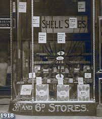A window promoting the launch of Woolworths' new shoe goods department, selling stick on soles and heels and a selection of polish in 1918