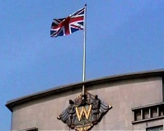 The Union Flag atop the Woolworth Building in London, England, which was the firm's home for fifty years from 1959-2009.