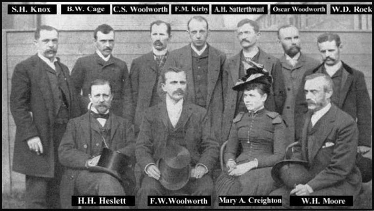 Managers' convention in Frank Woolworth's back yard in 1884 - the founding fathers of the five and ten cent business. Back row left to right: S.H. Knox, B.W. Cage, C.S. Woolworth, F.M. Kirby, A.H. Satterthwait, Oscar Woodworth, W.D. Rock. Front row: H.H. Heslett, F.W. Woolworth, Mary A Creighton and W.H. Moore