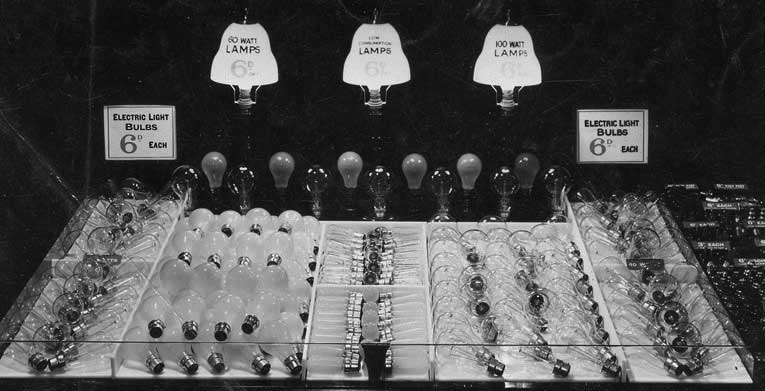 The lightbulb counter at F.W. Woolworth in Chorley Lancashire in 1935. Its 60 and 100 watt incandescent bulbs were labelled 'low consumption' and were sold for sixpence. To maximise sales, the selection of bakelite fittings was placed right next to the bulbs.