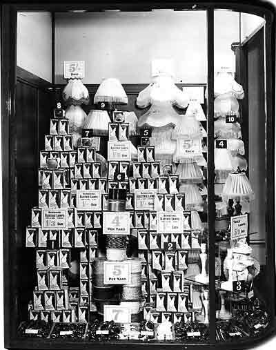 A bold display of Sunshine Electric Lamps, flex and fitments, shades and table lamps captured in a Woolworth's window in 1952