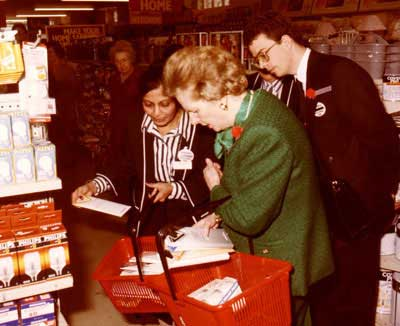 A famous local customer, the Prime Minister, the Rt Hon Margaret Thatcher MP (later Baroness Thatcher) shops for lightbulbs at Woolworths Grantham in 1987