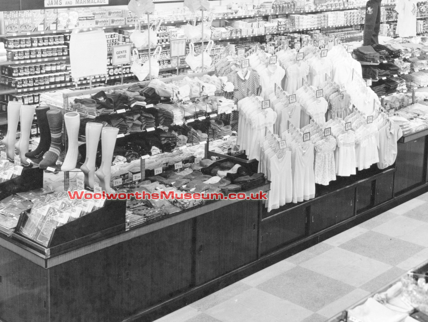 Hanging garment displays like this started to appear in Woolworth stores from 1950. Click the image for a larger version with more detail in a new window