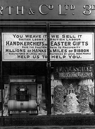 'You weave it, we sell it' - A popular window display for Woolworth stores in Lancashire during the 1930s, that served to emphasise the fact that nearly all of the firm's goods were British made at the time