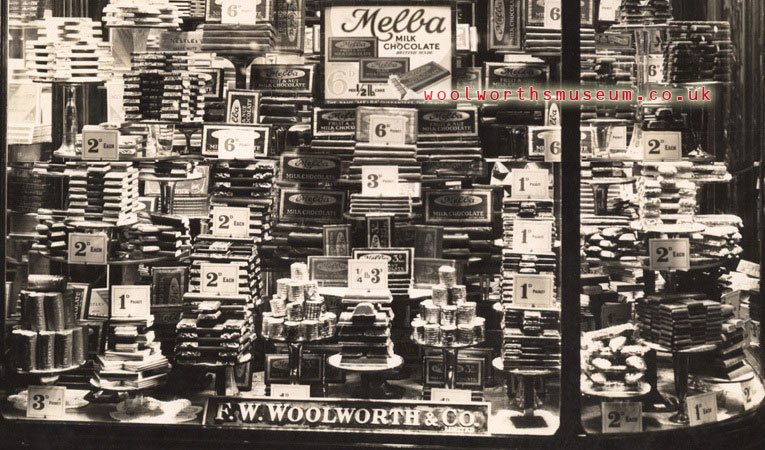 A window display of Melba chocolate bars in a variety of shapes and sizes from tuppence to sixpence at Woolworths in the 1930s