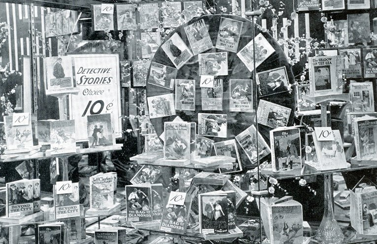 A window full of detective story books, pictured at an American Woolworth five-and-ten in around 1930