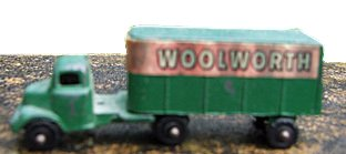 A tiny die-cast metal Woolworth lorry from the 1930s. These sold for five cents in the USA and threepence in Great Britain
