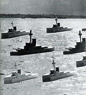 A flotilla of Woolworth sixpenny wooden boats from the 1938 range