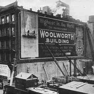 "Announcing the construction of the Woolworth Building - ""highest in the world"".  Manhattan got a surprise on their way to work when they found who had been buying all of the land in Broadway and Barclay Streets."