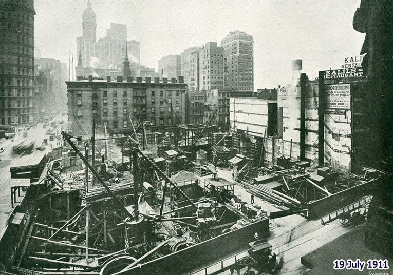 Construction of the Woolworth Building - the working platform at street level and a general view of the site. The picture was taken on 19 July 1911 and appeared in 'Engineering' Magazine on 5 January 1917