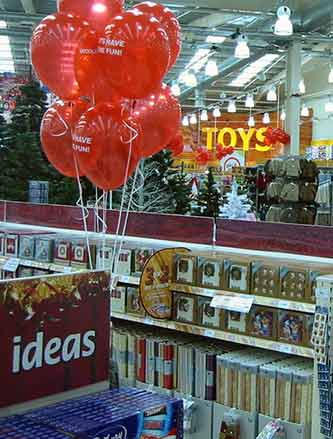 3 for 2 Christmas Cards, Gift Wrap and Tags on the counters at the Tamworth, Staffordshire out-of-town Woolworths in 2004